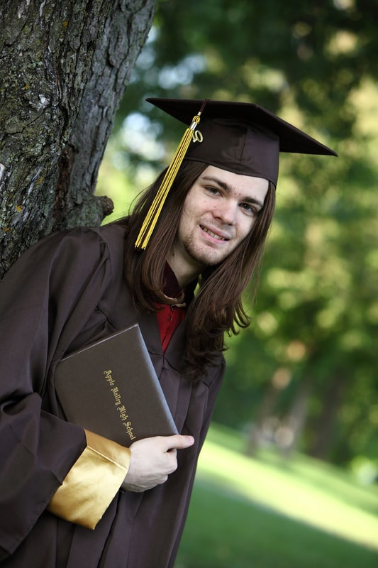 Daniel in Cap and Gown - ABLEnow enables people like my son to save for their futures.