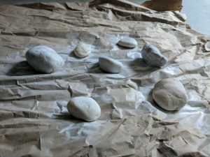 Spray rocks with a basecoat
