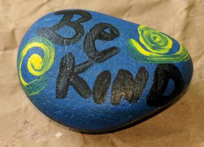 Painted Rock my son found - says be kind. The back says #PensacolaRocks