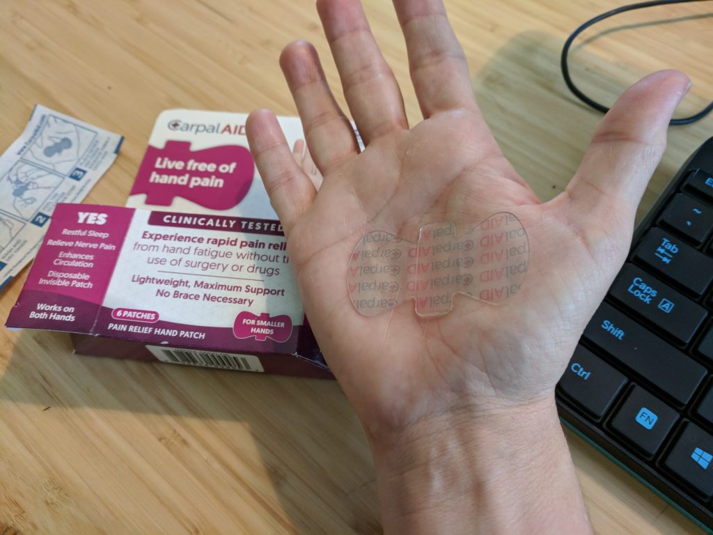 CarpalAid is clear and barely visible on the palm. It helps treat Carpal Tunnel Syndrome by gently lifting the tissues in the palm and relieving pressure on the median nerve.