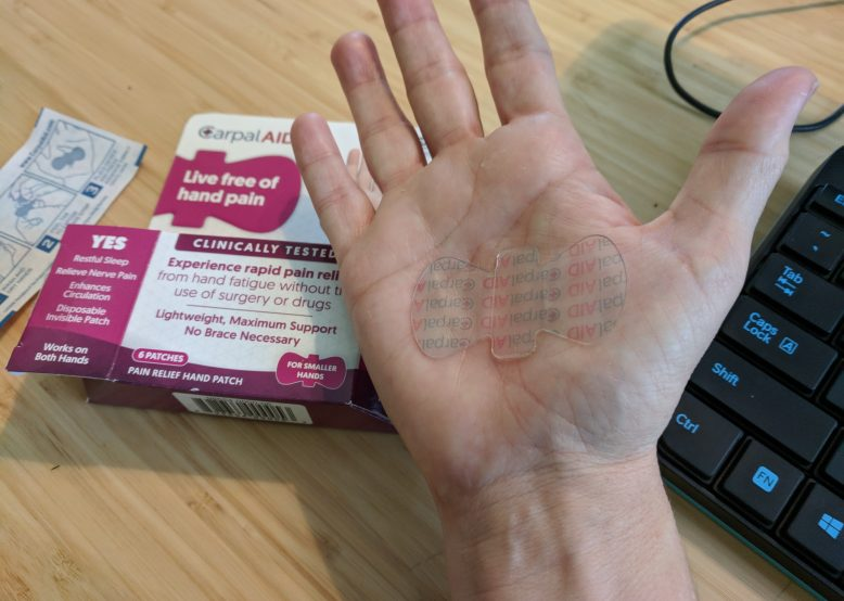 CarpalAid is clear and barely visible on the palm.