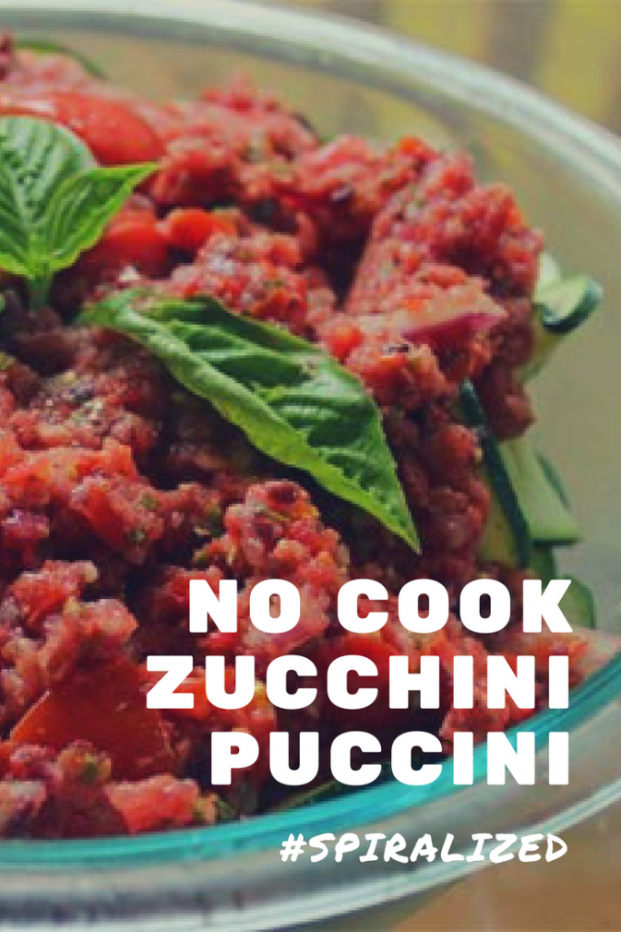Fresh tomatoes, zucchini, kalamata olives, fresh basil. No cook Zucchini Puccini showcases a mouthwatering flavor medley. Raw food vegan, paleo