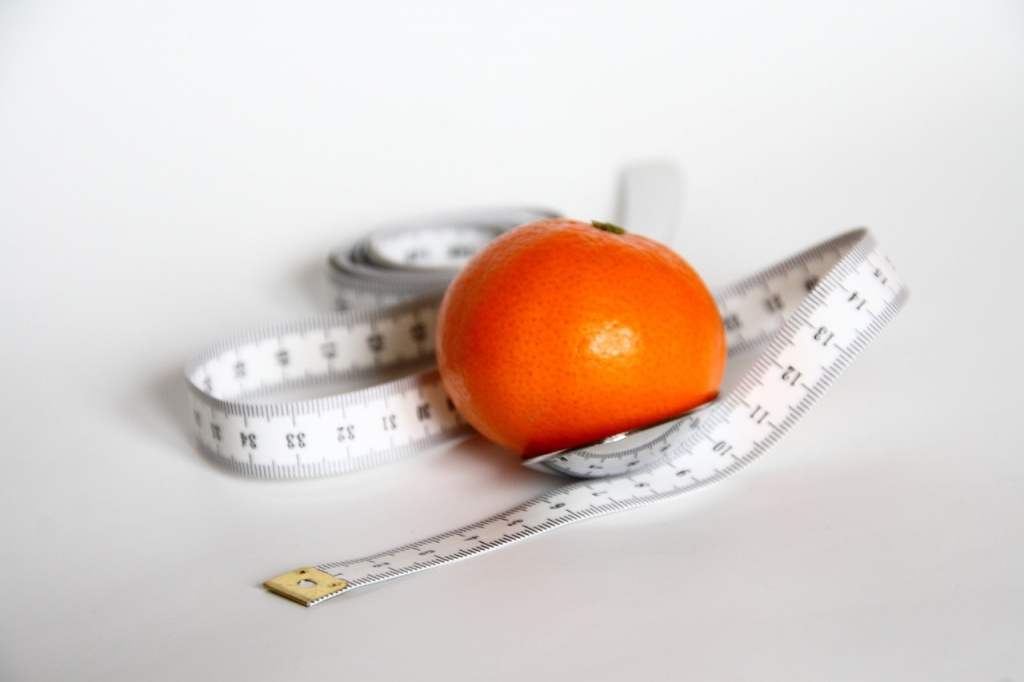 Losing weight - orange with a tape measure
