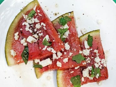 Grilled Watermelon with Feta and Mint - Sure, it's fun to sit outside in your shorts and drip juice up to your elbows, but grilling watermelon and topping it with feta and fresh mint adds a whole unexpected level of sophistication.